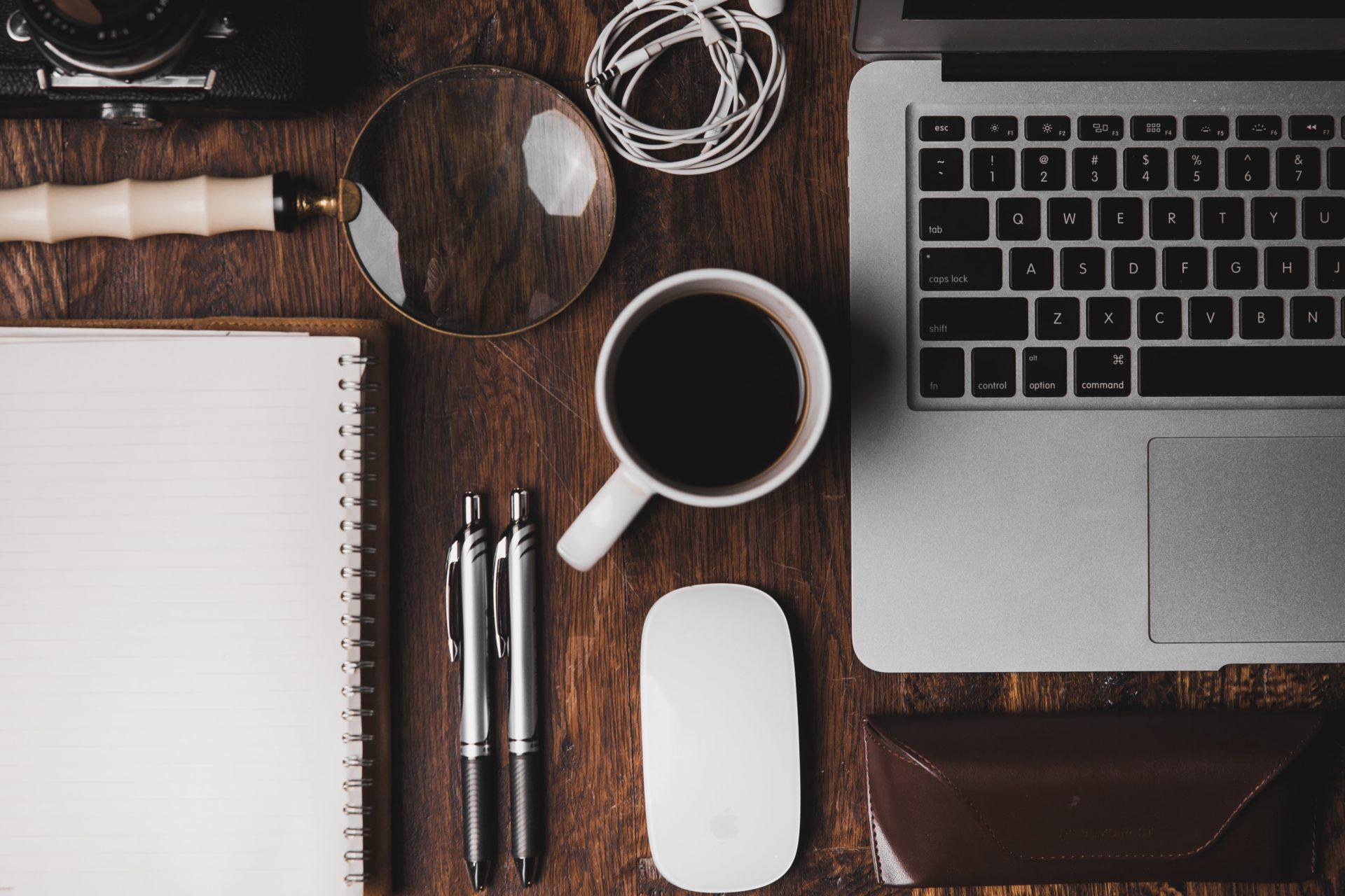 laptop, coffee, pencils, notebook